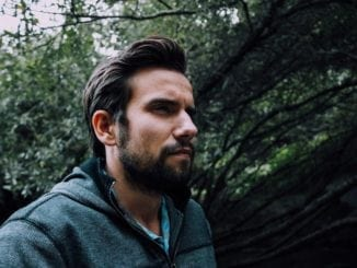 single man walking woods