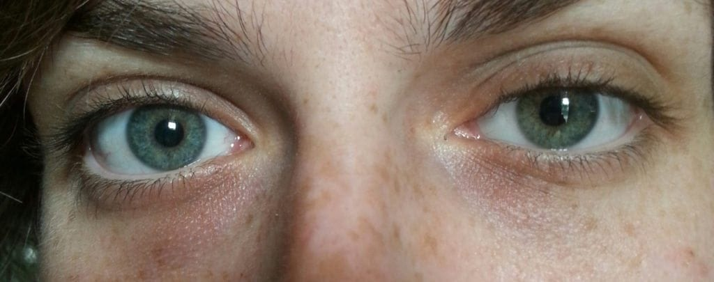 Girl with green shirt has some blue eyes
