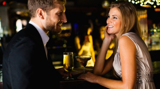 women flirts with other guy bar