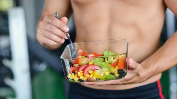 raw vegetables and fruit man eating salad