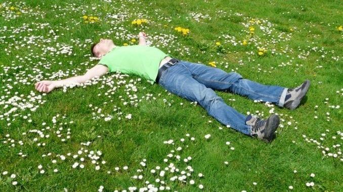 man sleeping grass