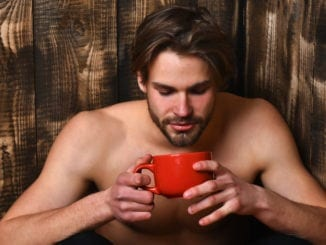 attractive man drinking tea coffee beard