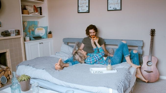 couple eating bed