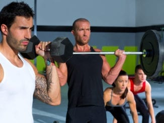 attractive men exercise gym