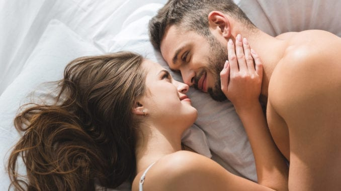 couple in love talking in bed