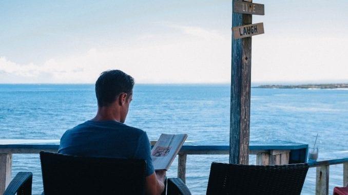 man reading book depressed