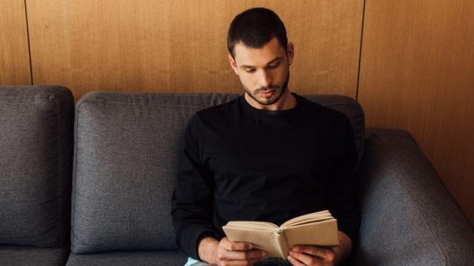 man reading book